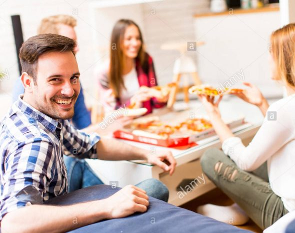 group-of-friends-eating-pizza-together-at-home-G1KWYE